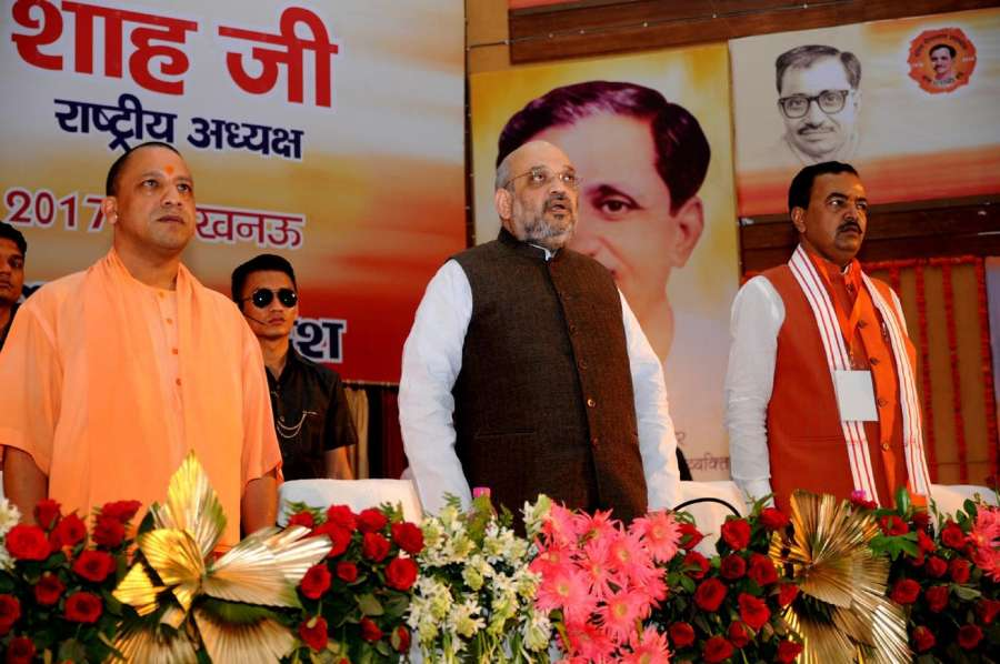 Lucknow: BJP chief Amit Shah during a party programme in Lucknow on July 29, 2017. Also seen Uttar Pradesh Chief Minister Yogi Adityanath and Deputy Chief Minister Keshav Prasad Maurya (Photo: IANS) by .