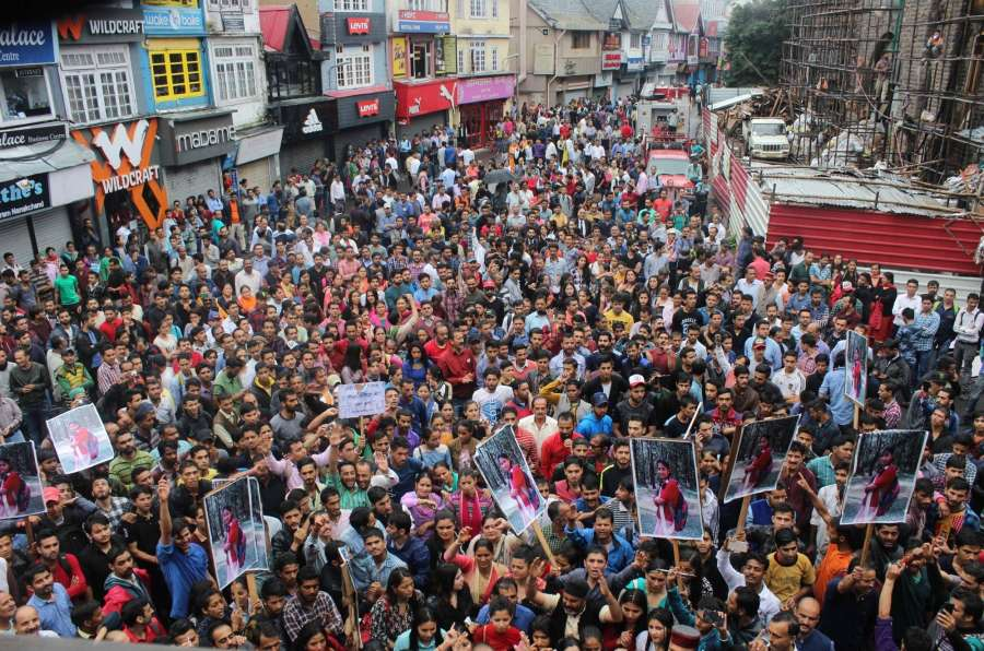 Shimla: People in large numbers stage a demonstration to demand justice for the 16-year-old gang-rape victim, whose body was found in the forests in Kotkhai town in Shimla district on 6th July; in Shimla on July 20, 2017. (Photo: IANS) by .