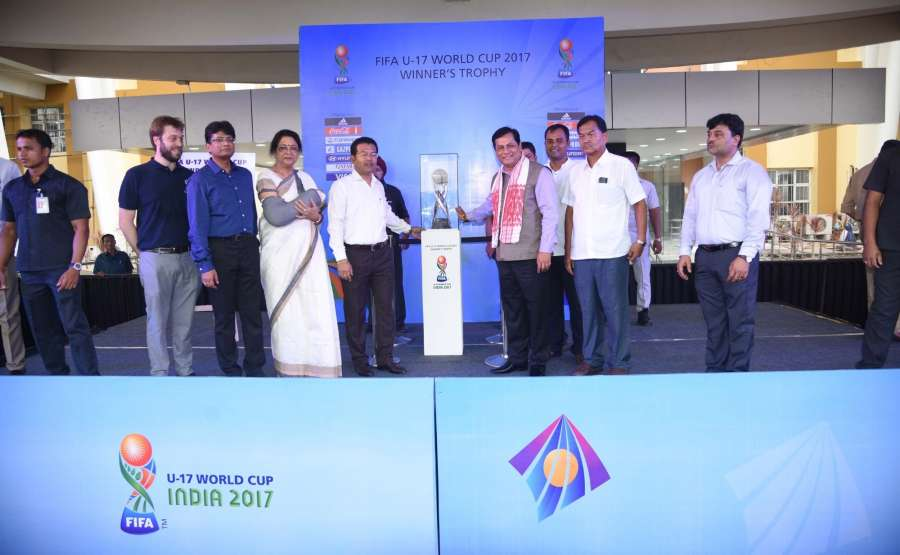 Guwahati: Assam Chief Minister Sarbananda Sonowal unveils the FIFA U 17 World Cup trophy before its Journey to other venues of FIFA World Cup at Indira Gandhi Sports complex in Guwahati on Aug 26, 2017. Also seen FIFA U-17 World Cup tournament director Javier Ceppi. (Photo: IANS) by .
