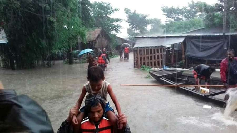 BHADRAPUR, Aug. 13, 2017 (Xinhua) -- Rescuers evacuate residents suffering from flood in Bhadrapur, Nepal, on Aug. 12, 2017. Monsoon-induced floods have created havoc across the low-lying areas known as Terai region in Nepal since Friday night. (Xinhua/IANS) by .