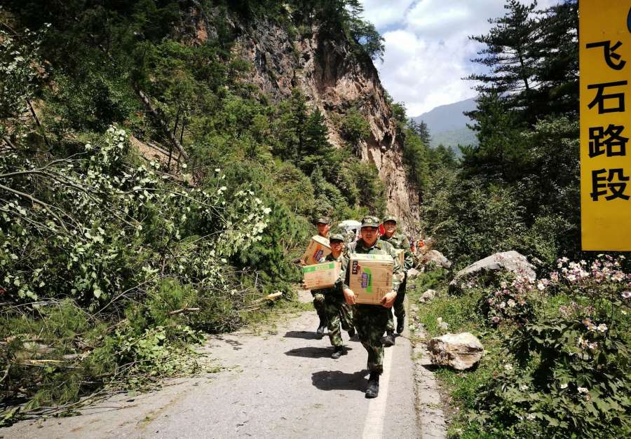 JIUZHAIGOU, Aug. 9, 2017 (Xinhua) -- Rescuers carry relief supplies in quake-hit Jiuzhaigou County, southwest China's Sichuan Province, Aug. 9, 2017. Rescue work continued after a 7.0-magnitude earthquake struck Jiuzhaigou, a popular tourist destination, Tuesday night.(Xinhua/Cai Biwei/IANS) by .