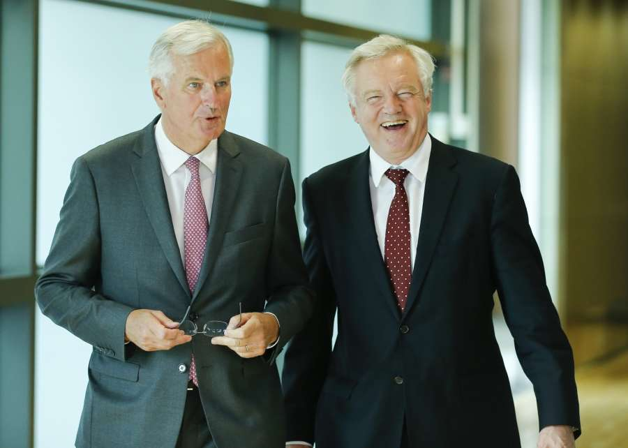 """BRUSSELS, Aug. 28, 2017 (Xinhua) -- British Brexit Secretary David Davis (R) and European Union's chief Brexit negotiator Michel Barnier arrive to address the media prior to the third round of Brexit talks in Brussels, Belgium, Aug. 28, 2017. The European Union (EU) on Monday urged Britain to take a more serious stance and quickly provide official positions on all Brexit issues as the latter called for more """"flexibility and imagination"""" on both sides in the third round talks. (Xinhua/Ye Pingfan/IANS) by ."""