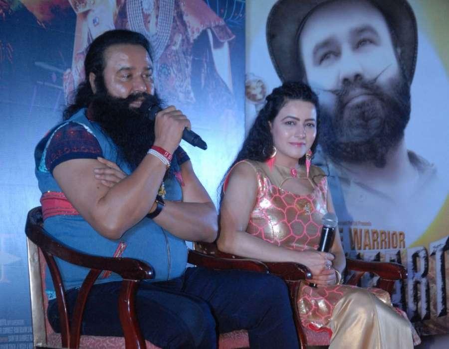 Mumbai: Dera Sacha Sauda chief Gurmeet Ram Rahim Singh along with his daughter Honeypreet Insan during the success party of film MSG The Warrior Lion Heart in Mumbai on Oct 19, 2016. (Photo: IANS) by .