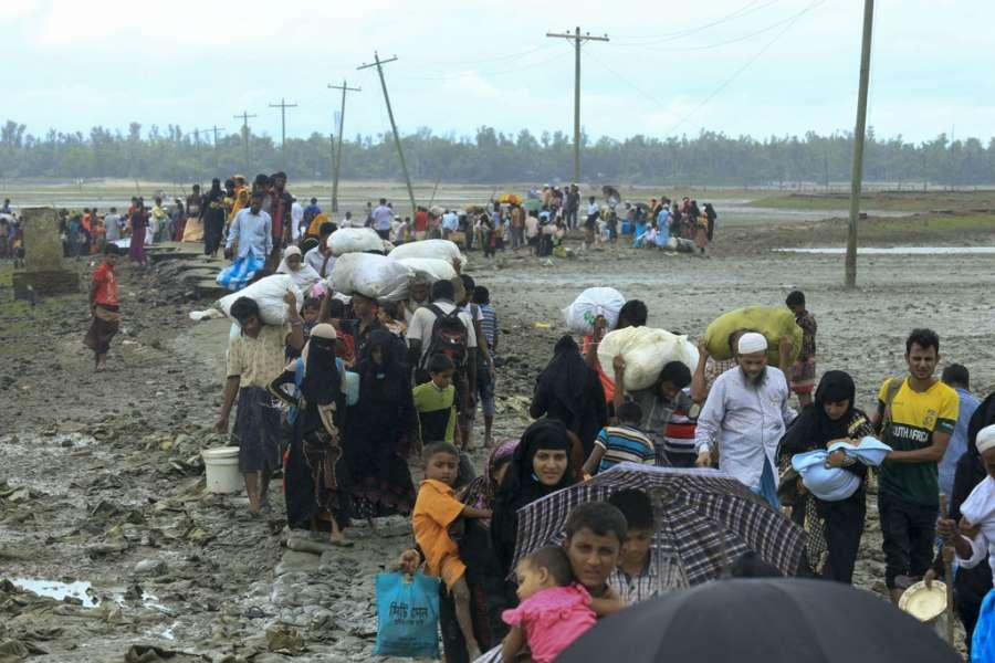 Dakhinpara: Rohingya refugees arrive at Shah Porir Dwip in Dakhinpara ofBangladesh from Rasidong in Myanmar, on Sept 13, 2017. (Photo: bdnews24/IANS) by .
