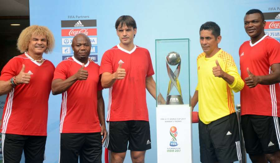 Mumbai: FIFA legends Carlos Valderrama, Fernando Morientes, Marcel Desailly, Jorge Campos and Emmanuel Amuneke unveil the FIFA U-17 World Cup Trophy during the curtain raiser function of FIFA Under 17 World Cup 2017 at Dr DY Patil Stadium in Mumbai on Sept 6, 2017. (Photo: IANS) by .