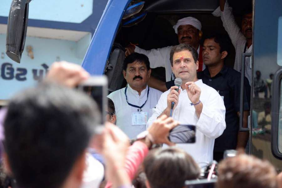 Hanjadapar: Congress Vice President Rahul Gandhi addresses during a road show at Hanjadapar village in Dwarka district of Gujarat on Sept 25, 2017. (Photo: IANS) by .