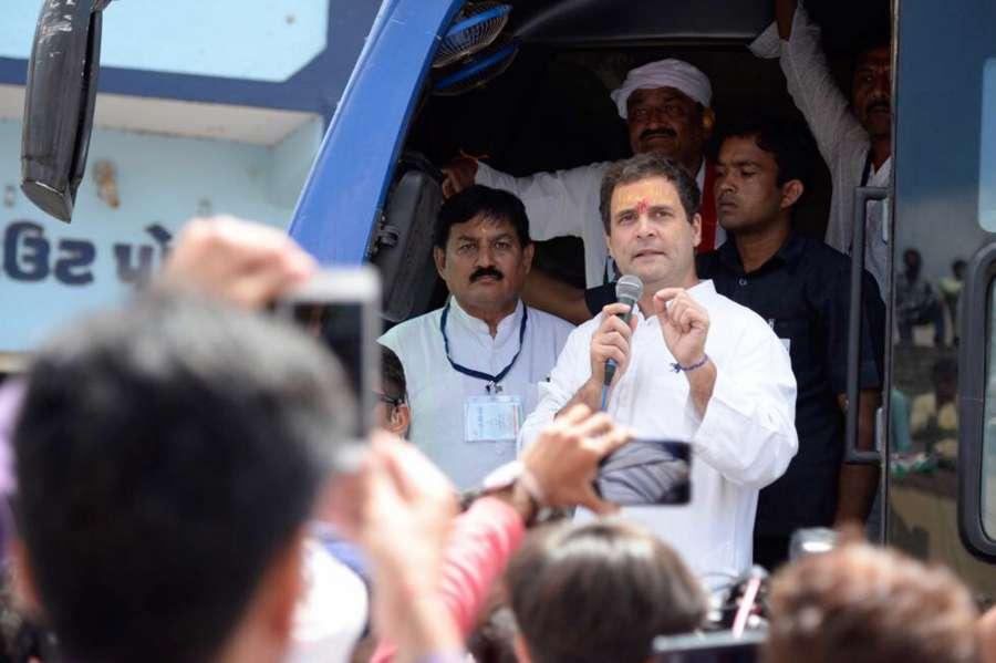 Hanjadapar: Congress Vice President Rahul Gandhi addresses during a road show at Hanjadapar village in Dwarka district of Gujarat on Sept 25, 2017. (Photo: IANS) by .