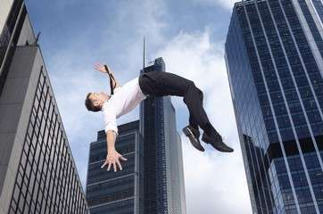 Businessman high jumping by .
