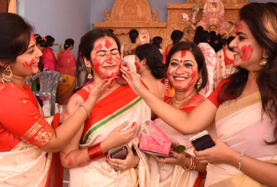 Lucknow: Woman participate in Sindoor Khela - a ritual in which married woman apply vermilion to goddess Durga and thereafter to each other on the last day of Durga Puja - in Lucknow on Sept 30, 2017. (Photo: IANS) by .