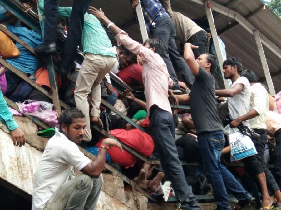 Mumbai: Stampede breaks out at on a narrow railway footover bridge connecting the Parel-Elphinstone Road stations of Western Railway in Mumbai on Sept 29, 2017. At least 22 commuters were killed. (Photo: IANS) by .