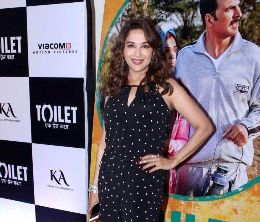 "Mumbai: Actress Madhuri Dixit Nene during the special screening of film ""Toilet: Ek Prem Katha"" in Mumbai on Aug 10, 2017. (Photo: IANS)s by ."
