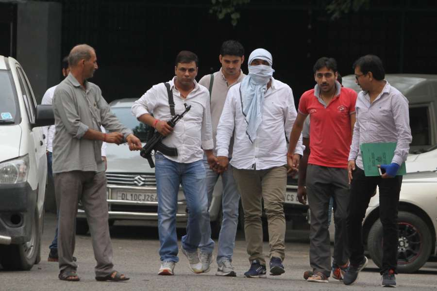 New Delhi: Delhi's most wanted criminal Sonu Dariyapur in the custody of the Special Cell team of the Delhi Police in New Delhi on Sept 14, 2017. He was wanted in several cases of murder and other heinous crimes. He was arrested from Narela area of north Delhi. (Photo: IANS) by .