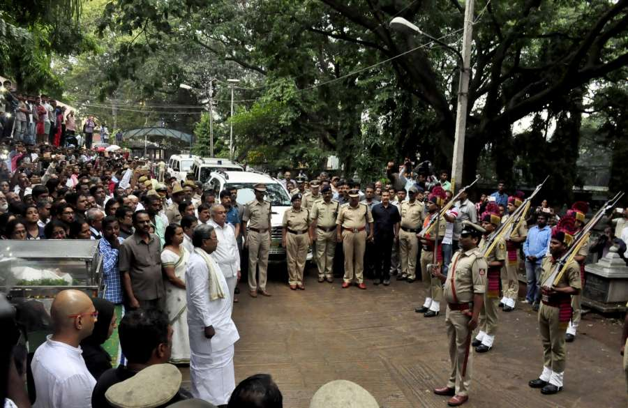 "Bengaluru: Karnataka Chief Minister Siddaramaiah take part at the funeral procession of Bengalaru journalist-turned-activist Gauri Lankesh in Bengaluru on Sept 6, 2017. Editor of the weekly Kannada tabloid ""Lankesh Patrika"", Lankesh was shot dead by unidentified men at her residence on Sept 5, 2017. (Photo: IANS) by ."