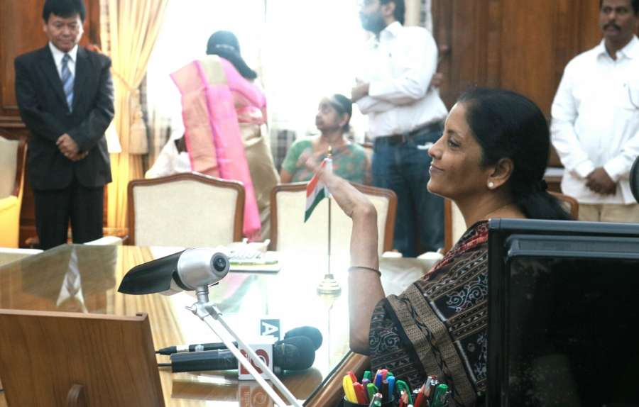 New Delhi: Nirmala Sitharaman takes charge as Union Defence Minister in the presence of Union Finance and Corporate Affairs Minister Arun Jaitley in New Delhi on Sept 7, 2017. (Photo: IANS) by .