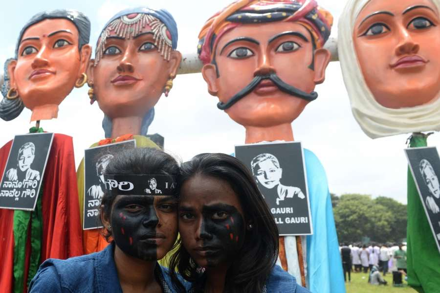 Bengaluru: Volunteers during a protest rally against the killing of journalist turned activist Gauri Lankesh at Central College Ground in Bengaluru on Sept 12, 2017. (Photo: IANS) by .