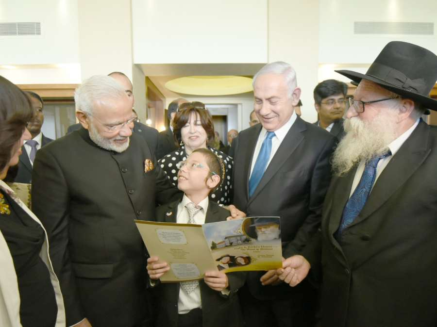 Jerusalem: Prime Minister Narendra Modi meets Moshe Holtzberg, the little boy who was orphaned in the 26/11 terror attack on the Chabad House, in Jerusalem, Israel on July 5, 2017. (Photo: IANS/PIB) by .