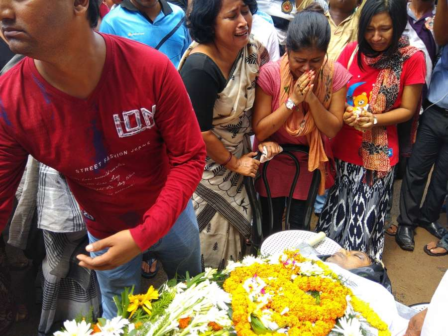 Agartala: People pay tribute to Shantanu Bhowmik, a journalist who was allegedly killed in an attack by tribal party cadres in Agartala on Sept 21, 2017. (Photo: IANS) by .