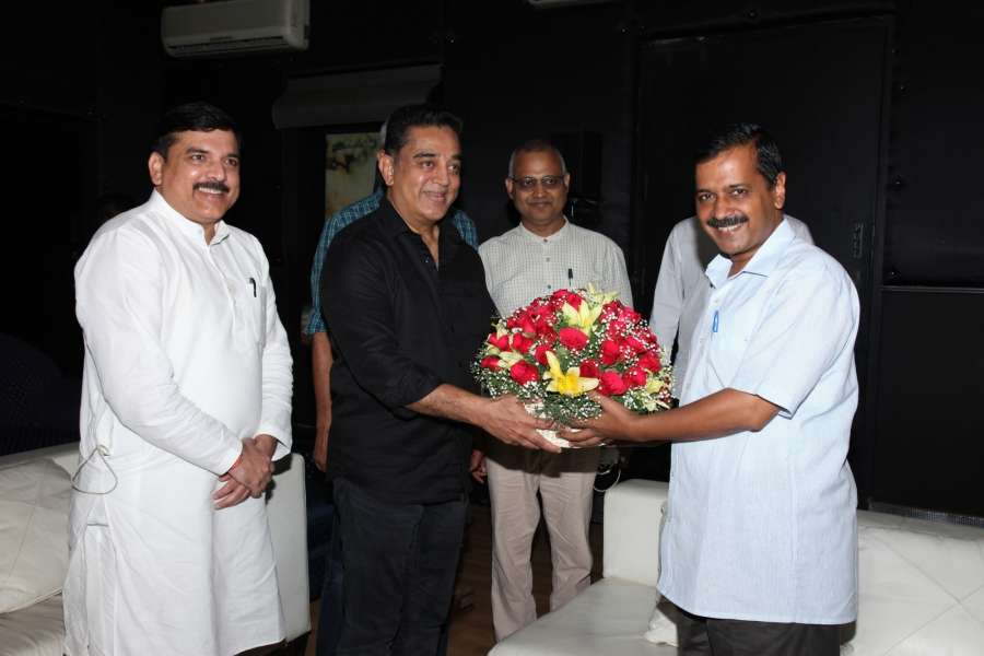 Chennai: Actor Kamal Haasan greets Delhi Chief Minister Arvind Kejriwal at his residence in Chennai on Sept 21, 2017. Also seen AAP leaders Sanjay Singh and Somnath Bharti. (Photo: IANS) by .