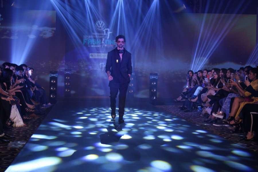 Mumbai: Actor Hrithik Roshan walk the ramp for designer Nikhil Thampi at