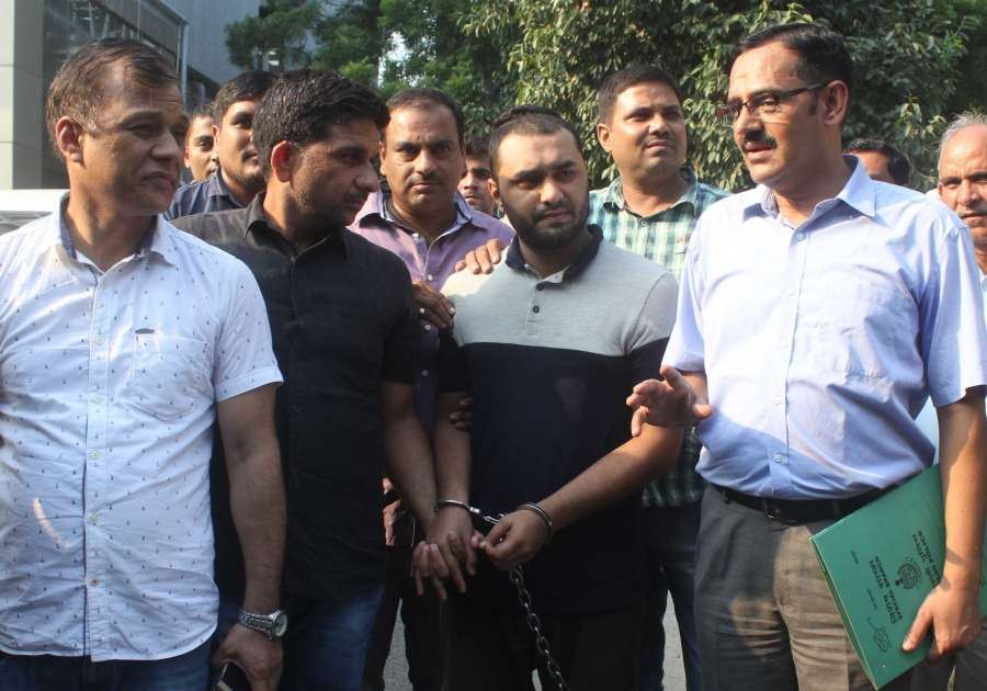 New Delhi: Al Qaeda terrorist Shumon Haq in the custody of Police's Special Cell officers at the Police headquarters in New Delhi on Sept 18, 2017. Haq who came with a mission to set up base Manipur or Mizoram and radicalise Rohingya Muslims to fight the military in Myanmar, was arrested near Shakarpur area of east Delhi on Sept 17, 2017. (Photo: IANS) by .