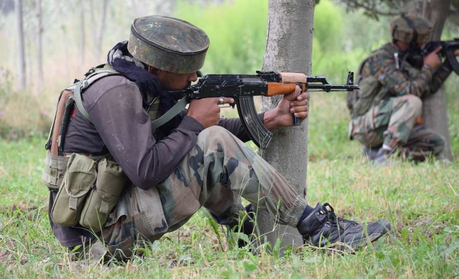Pulwama: Soldiers take position during a gun fight between security forces and militants in which four people were killed in Jammu and Kashmir's Pulwama district on Aug. 26, 2017. The victims included a policeman, a Central Reserve Police Force (CRPF) head constable, a trooper and a militant. (Photo: IANS) by .
