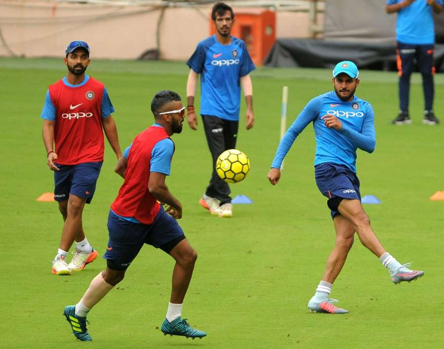 Bengaluru: India Cricket team players during a practice session ahead of the 4th ODI cricket match against Australia at Chinnasawamy Stadium , in Bengaluru on Sept. 26, 2017. (Photo: IANS) by .