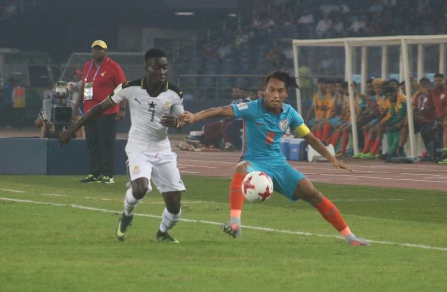 New Delhi: Amarjit Kiyam (Blue Jersey No-8) and Ibrahim Sulley (White Jersey No-7) in action during a FIFA U-17 World Cup Group A match between India and Ghana at Jawaharlal Nehru Stadium in New Delhi on Oct 12, 2017. (Photo: Bidesh Manna/IANS)​ by .