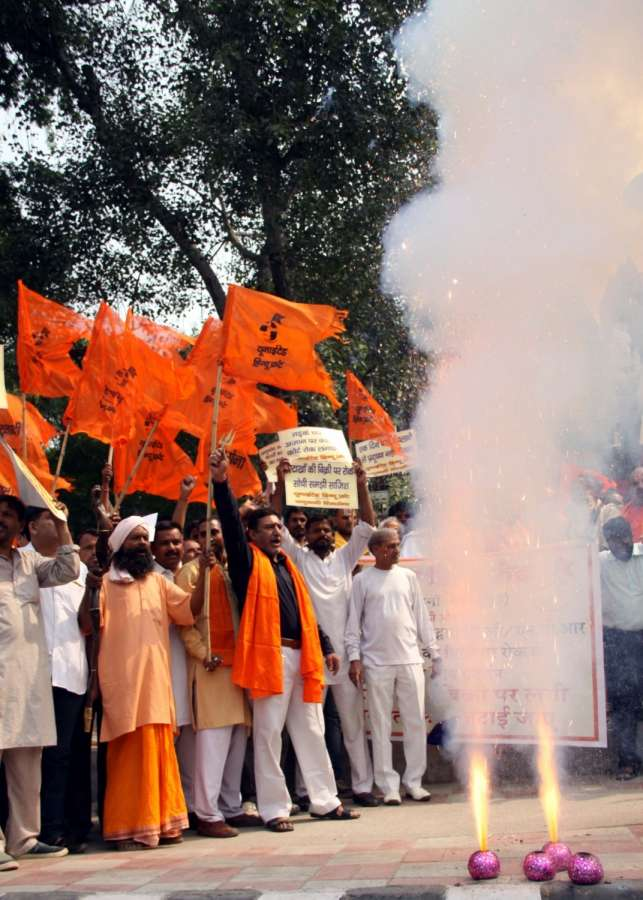 New Delhi: Right Wing Hindu activists stage a demonstration against Supreme Court's ban on the sale of fire crackers in Delhi and NCR this Diwali, in New Delhi, on Oct 13, 2017. The Supreme Court refused to modify its October 9 order banning the sale of fire crackers in Delhi and NCR this Diwali and expressed anguish that its order was being given a communal twist. (Photo: IANS) by .