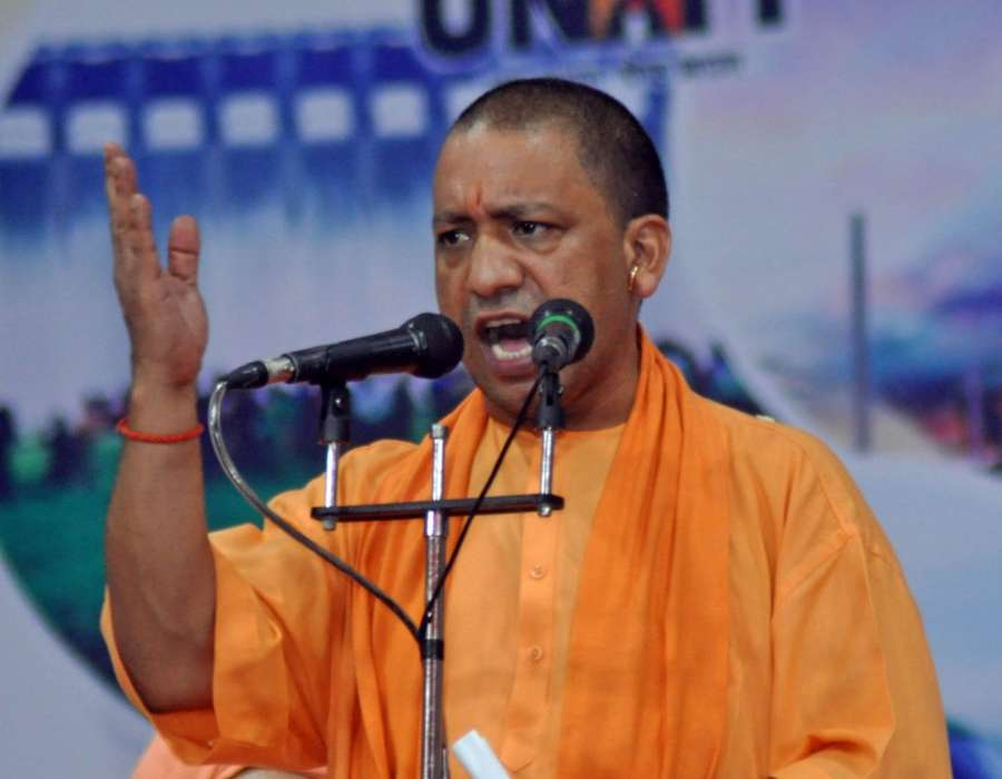 Surat: Uttar Pradesh Chief Minister Yogi Adityanath addresses during a public meeting near Surat on Oct 13, 2017. (Photo: IANS) by .