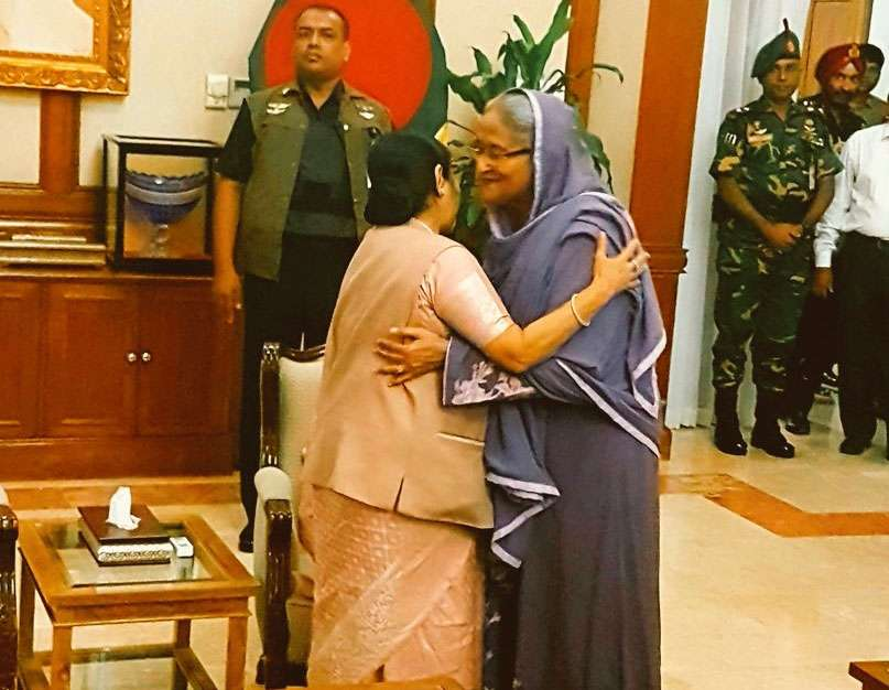 Dhaka: A photograph tweeted by Official Spokesperson of Ministry of External Affairs, Raveesh Kumar where External Affairs Minister Sushma Swaraj is seen hugging Bangladesh Prime Minister Sheikh Hasina in Dhaka, Bangladesh on Oct 22, 2017. (Photo: Twitter by .