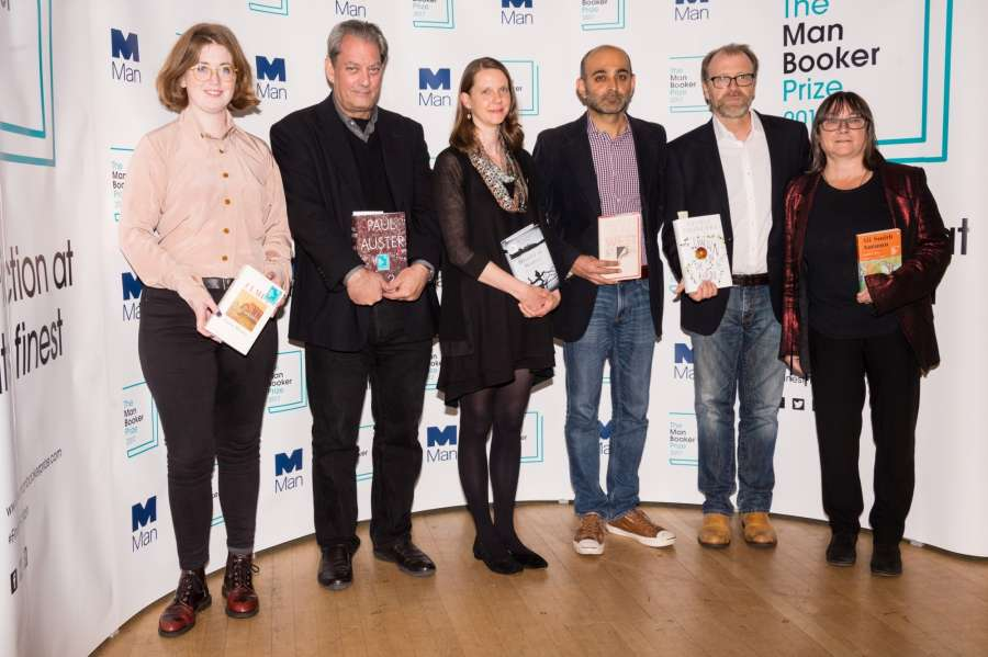 LONDON, Oct. 16, 2017 (Xinhua) -- The six Man Booker shortlisted novelists (from L to R) Fiona Mozley, Paul Auster, Emily Fridlund, Mohsin Hamid, George Saunders and Ali Smith pose with their books during a photocall at the Royal Festival Hall in London, Britain, on Oct. 16, 2017, one day ahead of the announcement of the winning book of the 2017 Man Booker Prize. Six novelists have been shortlisted for the 2017 Man Booker Prize, a literary prize awarded for the best original novel in English. (Xinhua/Ray Tang/IANS) by .