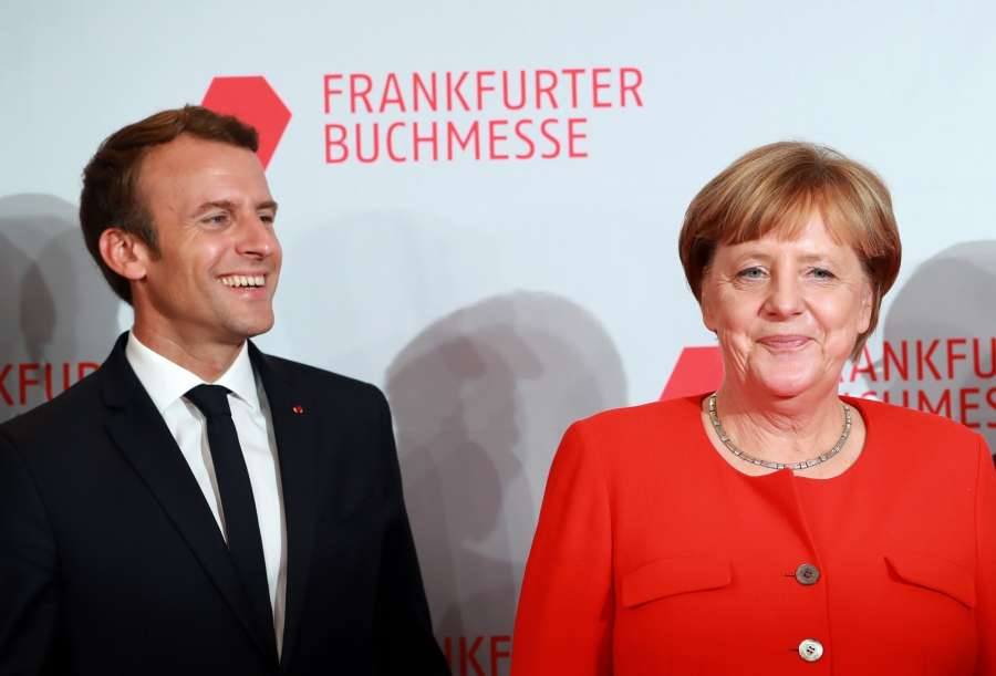 FRANKFURT, Oct. 10, 2017 (Xinhua) -- German Chancellor Angela Merkel (R) and French President Emmanuel Macron pose for photos as they arrive to open the 69th Frankfurt Book Fair in Frankfurt, Germany, on Oct. 10, 2017. German Chancellor Angela Merkel and French President Emmanuel Macron together opened the 69th Frankfurt Book Fair Tuesday evening. With around 200 French authors coming to Frankfurt, France is this year's guest of honor at the international publishing industry's biggest trade fair, where over 7,300 exhibitors from 102 countries and regions as well as around 278,000 visitors are expected. (Xinhua/Luo Huanhuan/IANS) by .