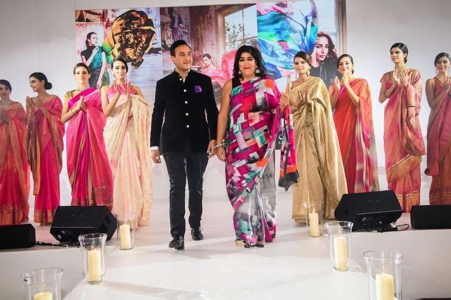 London: ​​Sudhanshu Swaroop and ​filmmaker Gurinder Chadha walk the ramp ​showcasing the creations of fashion designer Satya Paul during a programme in London , on Oct 1​6​, 2017. (Photo: Amlan Paliwal/IANS) by .