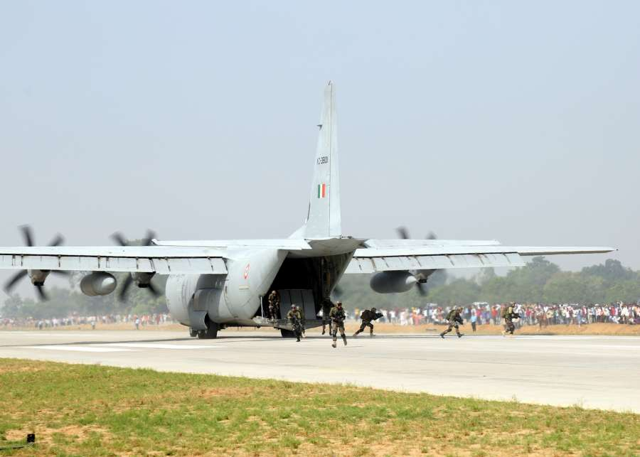 Unnao: Garud Commandos deplane from C-130 J Super Hercules transport aircraft for ground operations during IAF landing operations at Lucknow-Agra Expressway in Unnao on Oct 24, 2017. (Photo: IANS/DPRO) by .