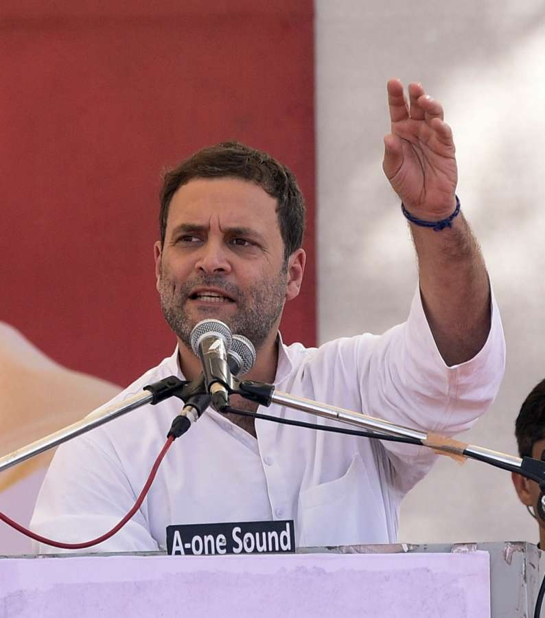 Gandhinagar: Congress Vice President Rahul Gandhi addresses during a public meeting in Gandhinagar on Oct 23, 2017. (Photo: IANS) by .