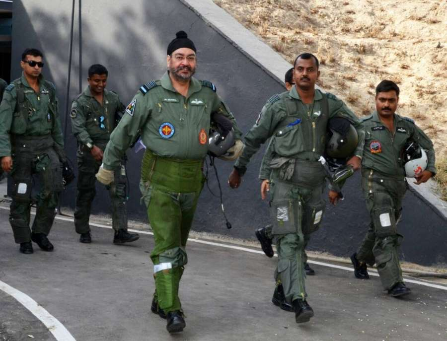 """Bhatinda: IAF chief B.S. Dhanoa arrives to fly a MiG-21 at Air Force station in Bhisiana of Punjab's Bhatinda, """"to honour the valour and supreme sacrifice of Kargil martyrs"""" on May 27, 2017. (Photo: IANS/DPRO) by ."""