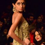 LAHORE, Oct. 15, 2017 (Xinhua) -- A model presents a creation by designer Shamsha Hashwani on the first day of the Bridal Fashion Week in eastern Pakistan's Lahore, on Oct. 14, 2017. The three-day event organized by Pakistan Fashion Design Council is to showcase the latest bridal collections. (Xinhua/Jamil Ahmed/IANS) by .