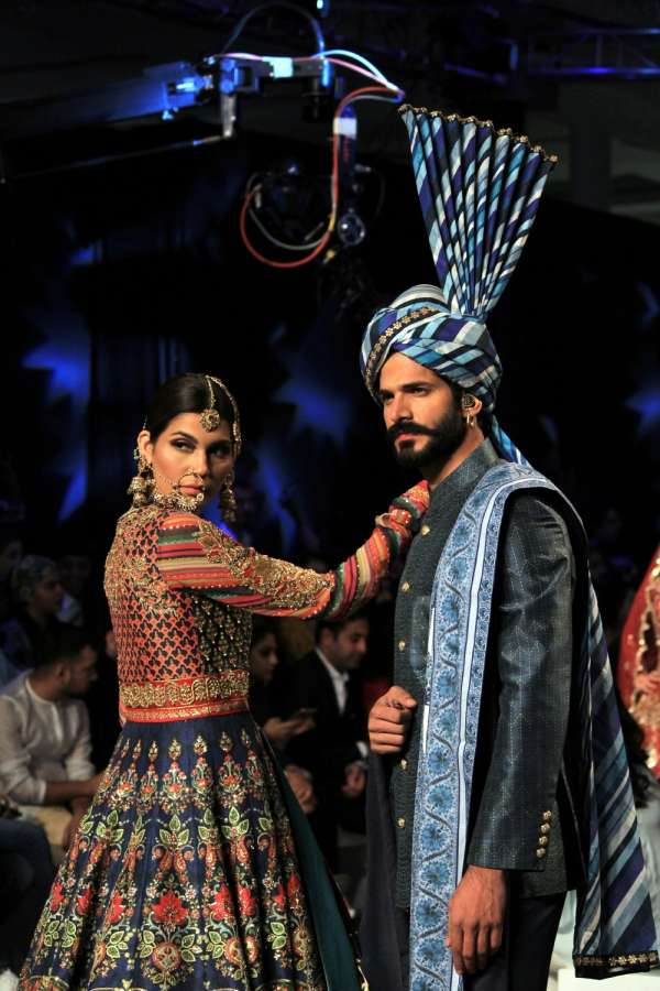 LAHORE, Oct. 17, 2017 (Xinhua) -- Models present creations by designer Nomi Ansari on the last day of the Pakistan Fashion Design Council (PFDC) Bridal Fashion Week in eastern Pakistan's Lahore on Oct. 16, 2017. (Xinhua/Jamil Ahmed/IANS) by .