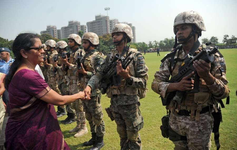 Ahmedabad: Union Defence Minister Nirmala Sitharaman meets with the Garud Commando Force of Indian Air Force during 'Know Your Air Force' program in Ahmedabad on Oct 6, 2017. (Photo: IANS) by .