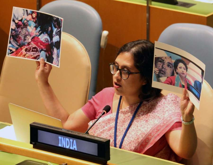 New York: Paulomi Tripathi, a First Secretary in India's UN Mission, held up the photograph of the body of Lt. Umar Faiyaz, a young soldier from the Indian state of Kashmir who was tortured and killed by Pakistan-backed terrorists, surrounded by mourners, and a picture of Pakistan's Permanent Representative Maleeha Lodhi displaying the picture of the Palestinian girl claiming she was Kashmiri, replies to Pakistan's permanent representative to UN Maleeha Lodhi's attacks on India at the United Nations General Assembly in New York on Sept 25, 2017. (Photo: Mohammed Jaffer/IANS) by .