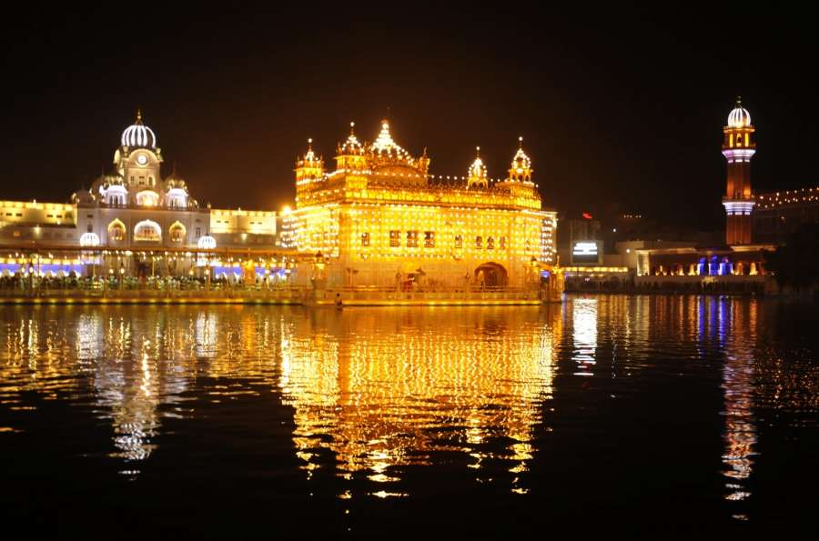 Amritsar: A view of spectacularly lit Golden Temple on the eve of Diwali in Amritsar, on Oct 18, 2017. (Photo: IANS) by .