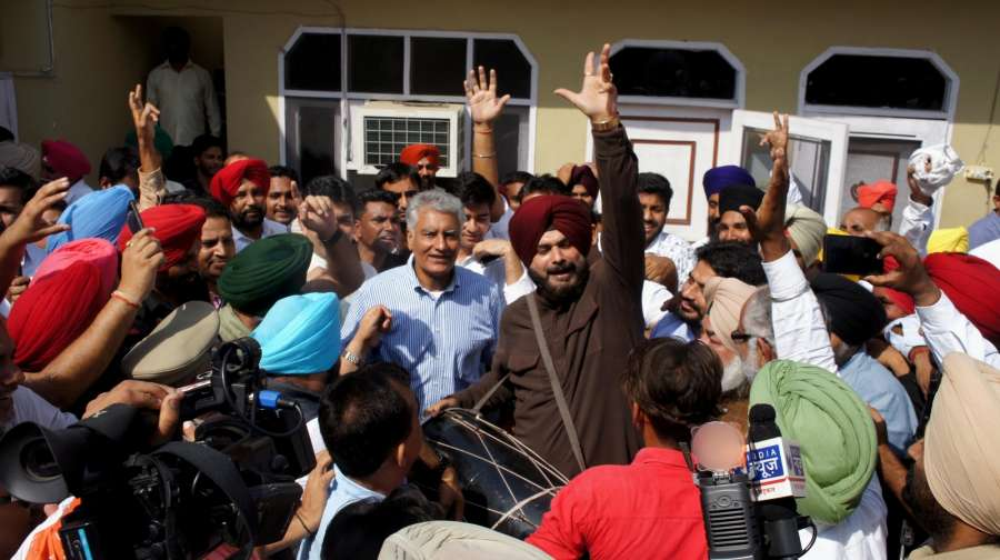 Gurdaspur: Punjab Congress chief Sunil Jakhar along with Navjot Singh Sidhu and other party leaders celebrates after winning by a margin of over 1.93 lakh votes in the recently concluded by polls to the Gurdaspur Lok Sabha seat, in Gurdaspur on Oct 15, 2017. (Photo: IANS) by .