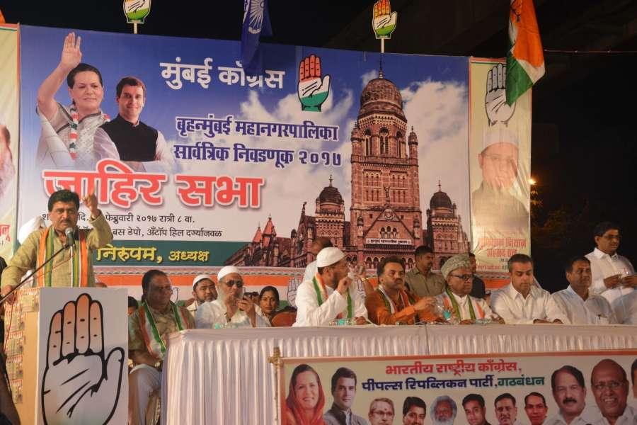 Mumbai: Maharashtra Congress chief Ashok Chavan addresses a rally ahead of BMC polls in Mumbai on Feb. 18, 2017. (Photo: IANS) by .