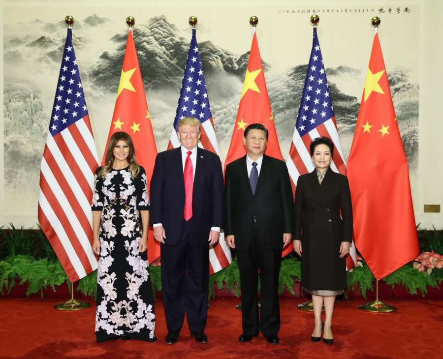 BEIJING, Nov. 9, 2017 (Xinhua) -- Chinese President Xi Jinping (2nd R) and his wife Peng Liyuan (1st R), and U.S. President Donald Trump (2nd L) and his wife Melania Trump pose for group photos at the Great Hall of the People in Beijing, capital of China, Nov. 9, 2017. Xi held a grand ceremony to welcome Trump on Thursday. (Xinhua/Lan Hongguang/IANS) by .