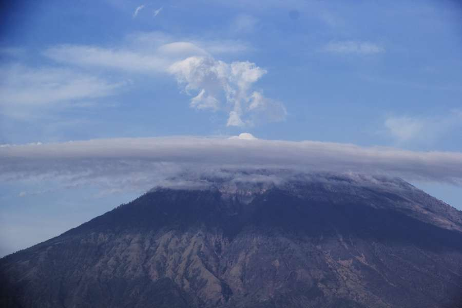 BALI, Sept. 26, 2017 (Xinhua) -- The Gunung Agung, or Mount Agung volcano is seen from Amed beach in Karangasem regency, Bali, Indonesia. Sept. 26, 2017. The number of evacuees has risen to more than 57,000 as Gunung Agung volcano in Bali resort island is potential to erupt, a senior official of disaster agency said on Tuesday. (Xinhua/M. Fauzi Chaniago/IANS) by .