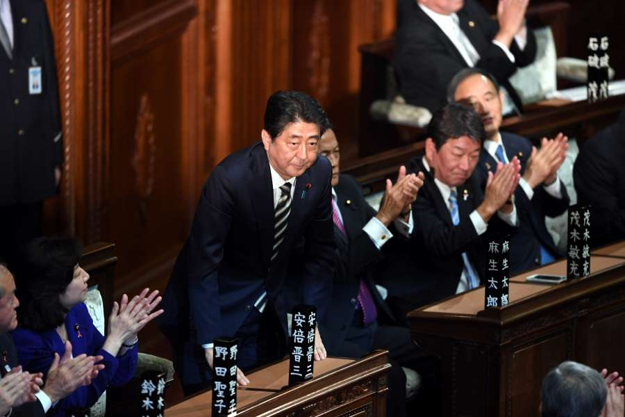 TOKYO, Nov. 1, 2017 (Xinhua) -- Shinzo Abe(3rd L), leader of the Liberal Democratic Party (LDP), bows as he is re-elected as prime minister, in Tokyo, Japan, on Nov. 1, 2017. Shinzo Abe was reelected as Japan's prime minister on Wednesday in both chambers of parliament. (Xinhua/Ma Ping/IANS) by .