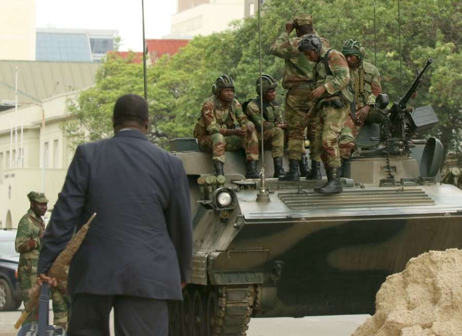 HARARE, Nov. 16, 2017 (Xinhua) -- Soldiers and an armed vehicle are seen in the city center of Harare, Zimbabwe, Nov. 16, 2017. Calm and peace have been urged for Zimbabwe where the military announced on Wednesday that it has taken control of all government institutions in the southern African country. (Xinhua/Stringer/IANS) by .