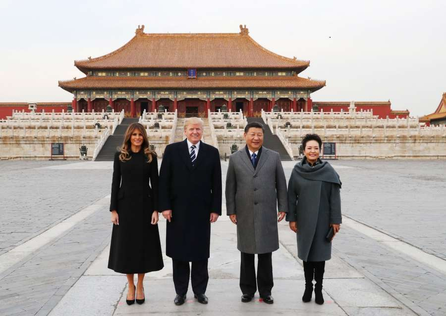 BEIJING, Nov. 8, 2017 (Xinhua) -- Chinese President Xi Jinping (2nd R) and his wife Peng Liyuan (1st R), and U.S. President Donald Trump (2nd L) and his wife Melania Trump pose for a photo in front of Taihedian, the Hall of Supreme Harmony, during their visit to the Palace Museum, or the Forbidden City, in Beijing, capital of China, Nov. 8, 2017. (Xinhua/Xie Huanchi/IANS) by .