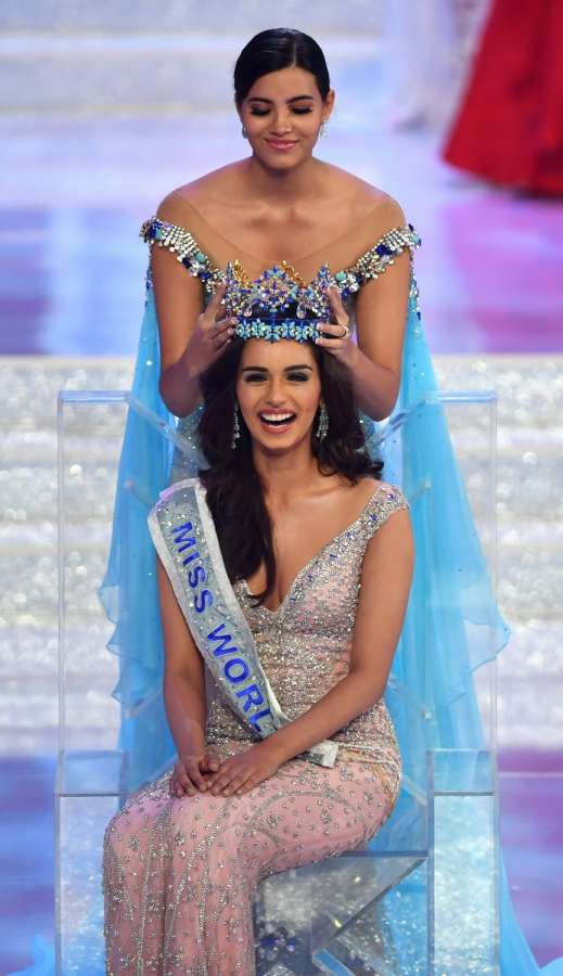Sanya: India's Manushi Chillar receives the crown after winning the Miss World 2017 pageant in Sanya, China on Nov 18, 2017. (Photo: Xinhua/IANS) by .