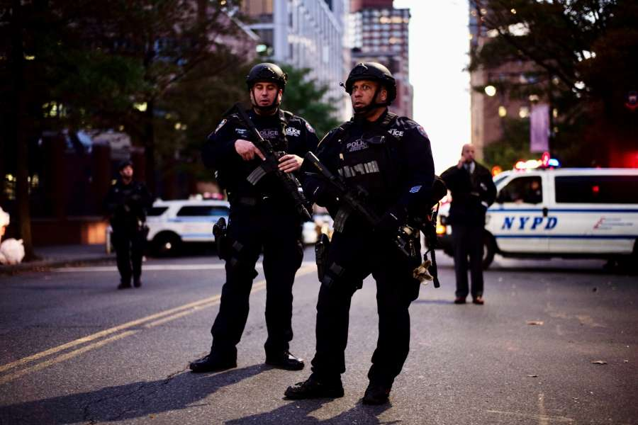 NEW YORK, Oct. 31, 2017 (Xinhua) -- Police officers stand guard near the site of an attack in lower Manhattan in New York, the United States, on Oct. 31, 2017. Eight people were killed and a dozen more injured after a truck plowed into pedestrians near the World Trade Center in New York City, the mayor said on Tuesday. (Xinhua/Li Muzi/IANS) by .